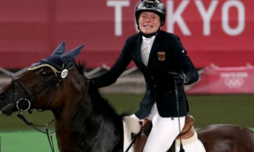 German coach thrown out for punching horse